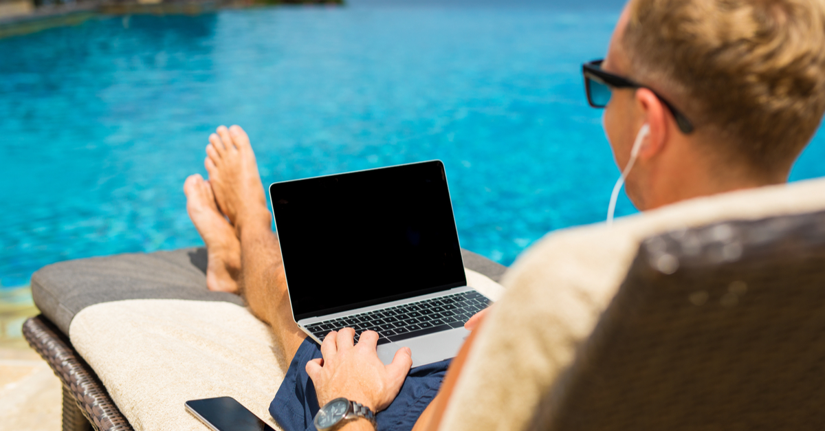 laptop by the pool